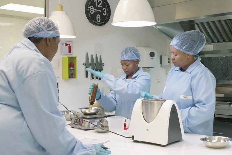 Food technologists working in test kitchen