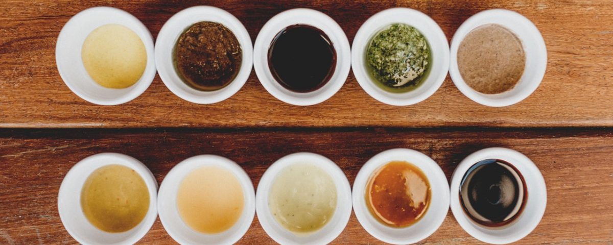 Various sauces in small bowls