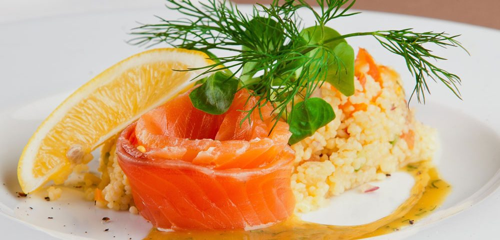 salmon and rice on white plate