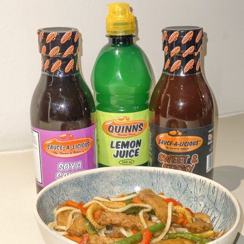 stirfry in bowl with sauces